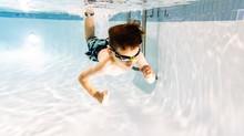Shirtless Cute Boy Swimming Underwater In Pool