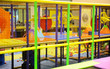 canvas print picture - Modern children playground indoor with lot of colorful toys and obstacles