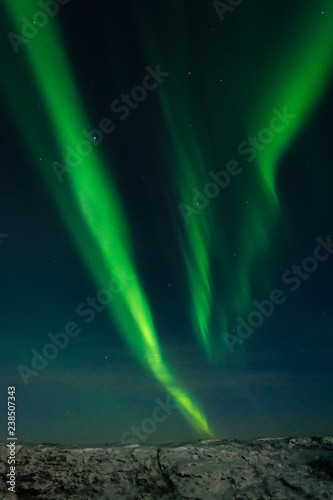 Fotografia, Obraz  Beautiful stripes of the northern lights, aurora in the night sky above the hills