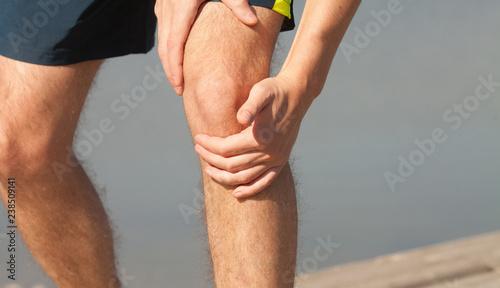 Pain in knee injury of sportsman Canvas Print
