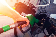 Refueling The Car At A Gas Station Fuel Pump. Man Driver Hand Refilling And Pumping Gasoline Oil The Car With Fuel At He Refuel Station. Car Refueling On Petrol Station. Fuel Pump At Station