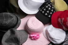 Various Hats All Piled Together On Display