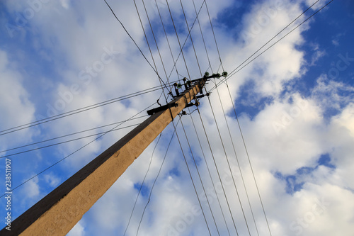 Fotografie, Obraz  Electric pole with wires against the sky