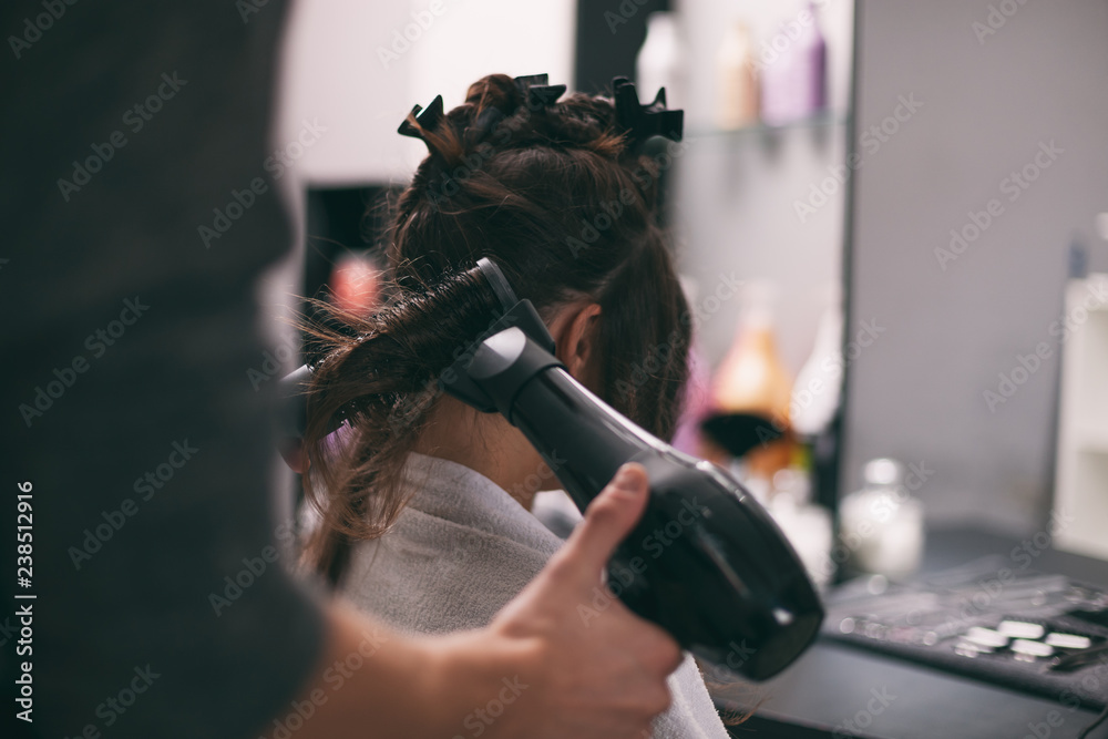 Fototapety, obrazy: Young woman getting new hairstyle at professional hair styling saloon.