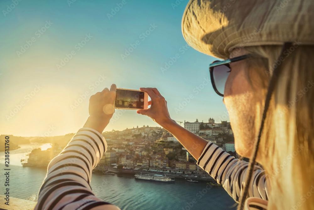 Fototapety, obrazy: Happy blonde woman - tourist shot on her smartphone camera