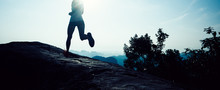 Young Fitness Woman Trail Runn...
