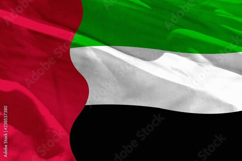 Fotografie, Obraz  Waving United Arab Emirates flag for using as texture or background, the flag is