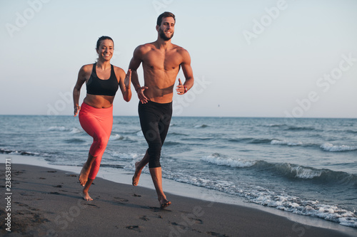 Man and Woman Running on Sandy beach