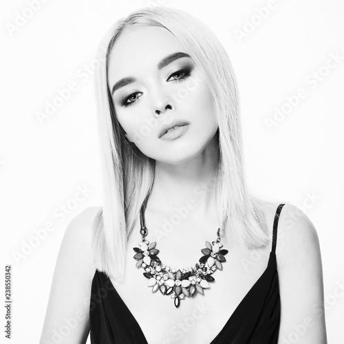Fotobehang womenART Beautiful young blonde in classic black dress and modern jewelry