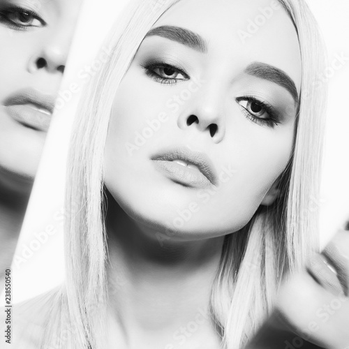 Fotobehang womenART Beautiful young blonde with classic makeup. Black and white portrait.