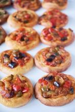 Freshly Baked Mini Pizzas Cocas