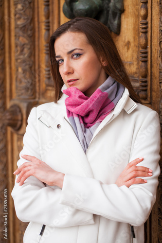 Fotografie, Obraz  Portrait of a young beautiful woman in white classic coat
