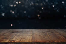 Dark Bokeh Background With Wooden Table