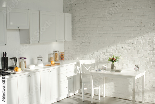 sunlight in white modern kitchen with cooking utensils - Buy this