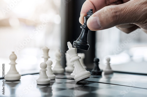 Hands of confident businessman colleagues playing chess game to development anal Fototapete