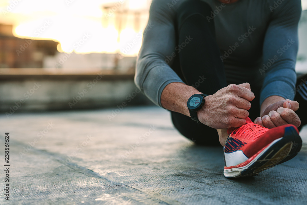 Fototapeta Close up of an athlete wearing shoes