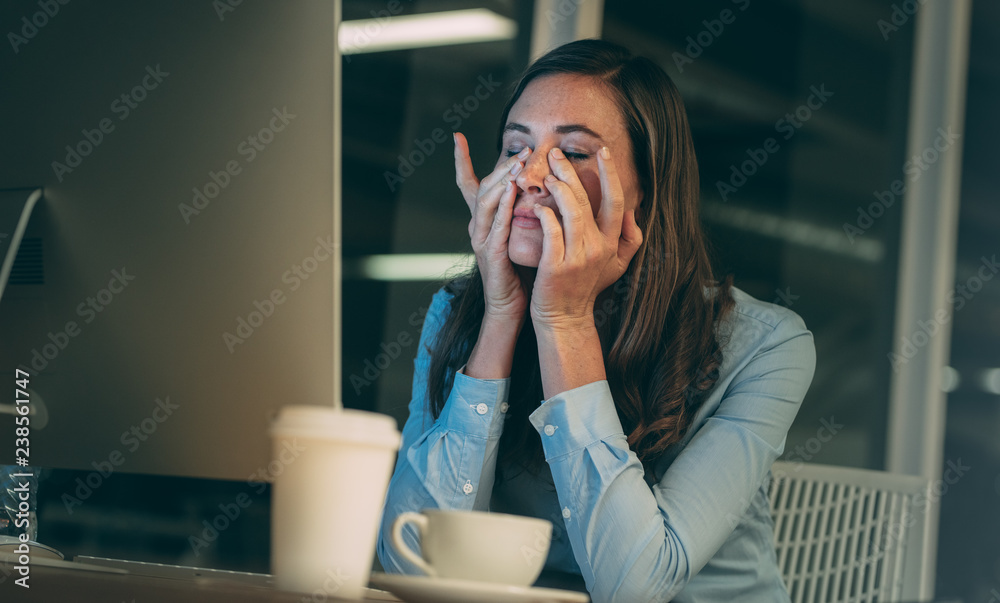 Fototapeta Businesswoman stressed out during work