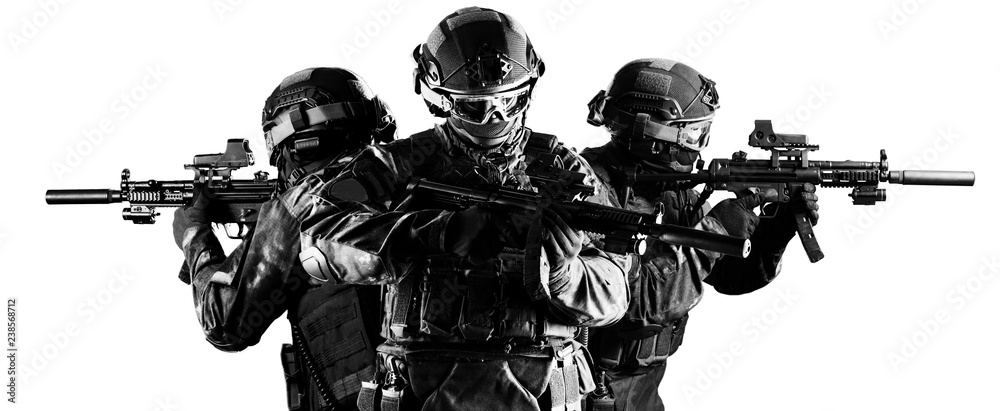 Fototapeta Group of fighters of a special unit covers the withdrawal of members of their team.