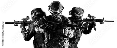 Fototapeta Group of fighters of a special unit covers the withdrawal of members of their team. obraz