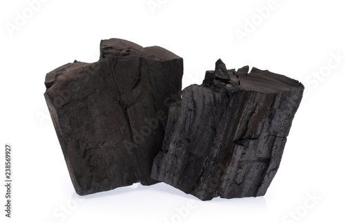 Photo  Black charcoal isolated on white background.