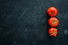 Fresh Red Tomatoes On The Old Background. Top View. Free Copy Space.