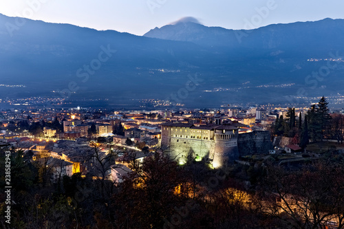 Poster Montagne Rovereto at dusk. Trentino, Italy.
