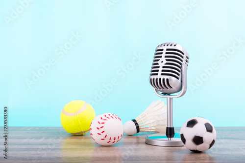 Photo  Concept sports commentator : The retro microphone put on the wooden table with f