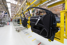 Car Door On Conveyor. Robotic Equipment Makes Assembly Of Car. Modern Car Assembly At Factory
