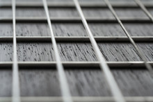Close Up View On Acoustic Guitar Neck With Strings (macro, Shallow Depth Of Field)