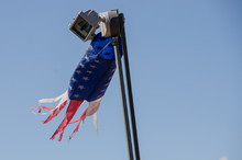 American Flag Windsock Blowing In The Breeze