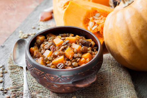 Fotografie, Obraz  Spicy curry with green lentils, pumpkin and raisins