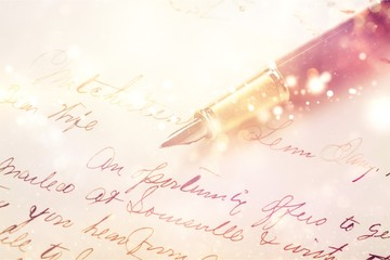 Fountain pen on handwritting background, close-up view