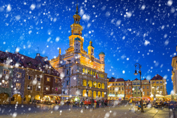 Old town of Poznan on a cold winter night with falling snow, Poland