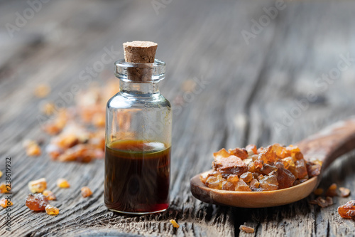 Obraz na plátně A bottle of myrrh essential oil with myrrh resin on a spoon