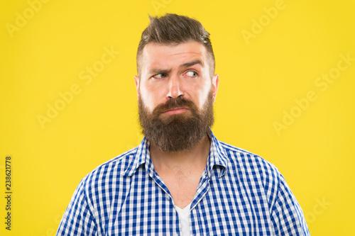 Fotografia, Obraz  Man serious face raising eyebrow not confident