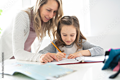 Papel de parede A Mother and Child doing homework at home