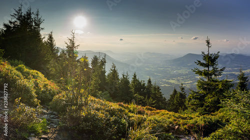 Photo  Sunset scenery on Smrk mountain in Moravskoslezske Beskydy in Czech republic wit