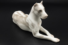 Antique Porcelain Figurine Of A Dog Deutsche Dogge Breed On The Black Background