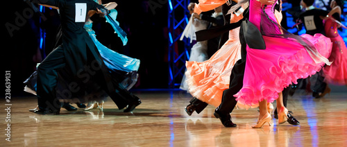 Spoed Foto op Canvas Dance School woman and man dancer latino international dancing