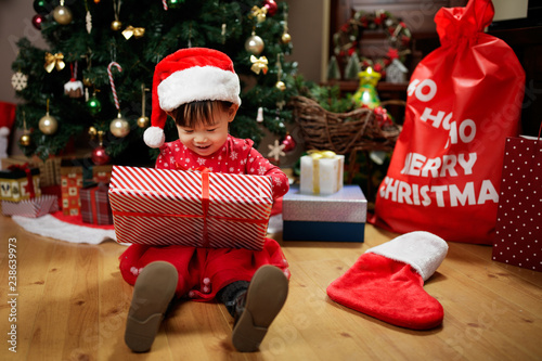 Toddler Baby Girl Wearing Santa Claus Costume Open Gift Box In Front