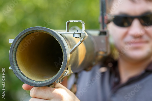 Photo Mercenary in black glasses with anti-tank rocket launcher, RPG in hand
