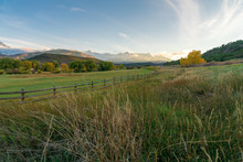 The Sun Is About To Set Over A Ranch In The Colorado Mountains Filled With Cows And Surrounded By Fences