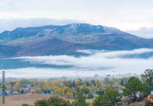 Fotografie, Obraz  Low lying clouds over a small mountain town