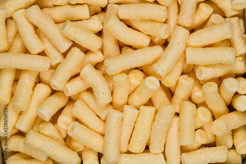 Valokuva  Salted corn puffs snack food texture background, close up detail