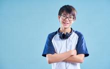 Portrait Of Asian Teenage Smil...