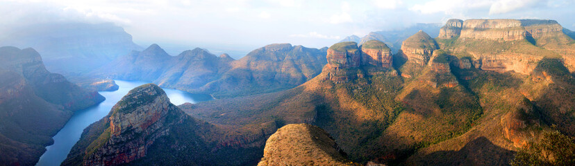Blyde River Canyon blue lake, Three Rondavels and God's Window, Drakensberg Mountains national park panorana on beautiful sunset light background, top view, South Africa, Mpumalanga Province