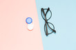 Leinwanddruck Bild - Glasses and contact lenses on two color pastel background, vision concept