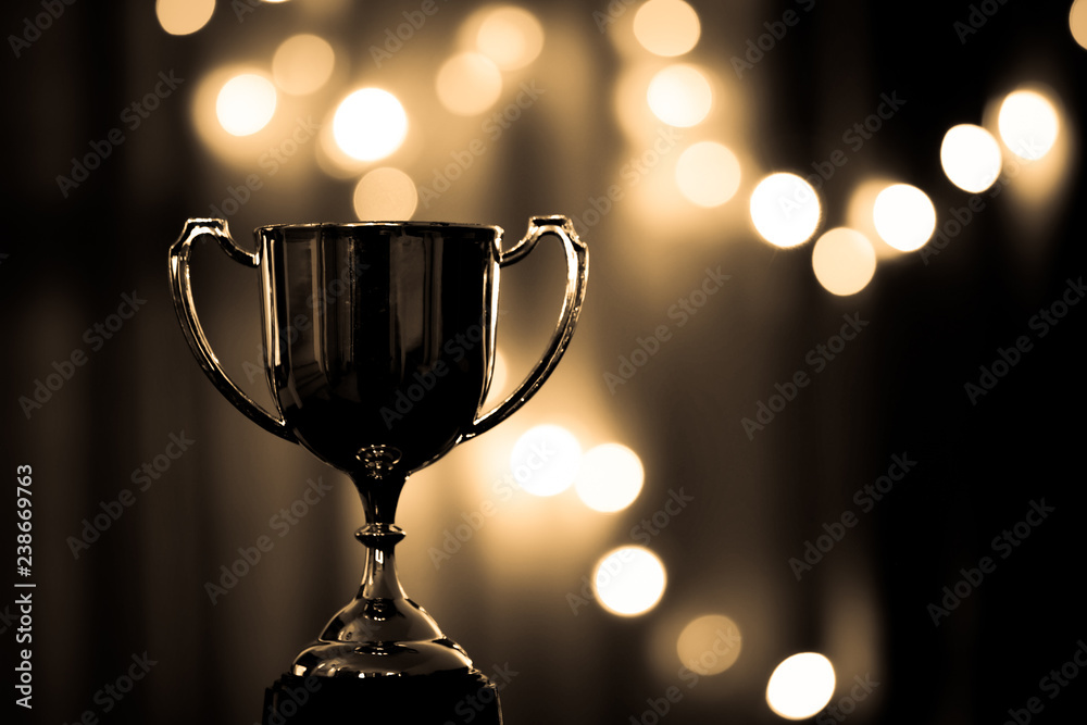 Fototapety, obrazy: Gold Trophy competition in the dark on the abstract blurred light background with copy space, Spectacular success Concept