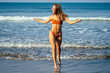 freedom and woman independence concept.Happy young girl jumping running on the tropical beach.Happy female model during summer vacation enjoying the sea breeze and fresh air.spf and sun block spa