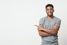 African-american Man Pointing Aside At Copy Space